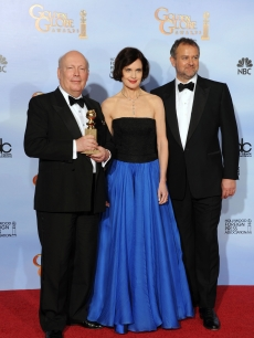 Writer Julian Fellowes, actors Elizabeth McGovern and Hugh Bonneville pose in the press room with the Best Mini-Series or Motion Picture Made for Television award for 'Downtown Abbey' at the 69th Annual Golden Globe Awards held at the Beverly Hilton Hotel, Beverly Hills, on January 15, 2012