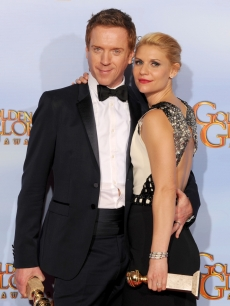 Damian Lewis and Claire Danes pose in the press room with the Best Television Series - Drama award for 'Homeland' at the 69th Annual Golden Globe Awards held at the Beverly Hilton Hotel, Beverly Hills, on January 15, 2012