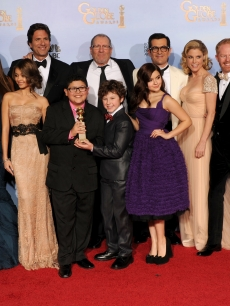 The cast of 'Modern Family' poses in the press room with the Best Television Series - Musical or Comedy award for 'Modern Family' at the 69th Annual Golden Globe Awards held at the Beverly Hilton Hotel on January 15, 2012