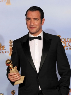 Jean Dujardin poses in the press room with the Best Performance by an Actor in a Motion Picture - Musical or Comedy award for 'The Artist' at the 69th Annual Golden Globe Awards held at the Beverly Hilton Hotel, Beverly Hills, on January 15, 2012