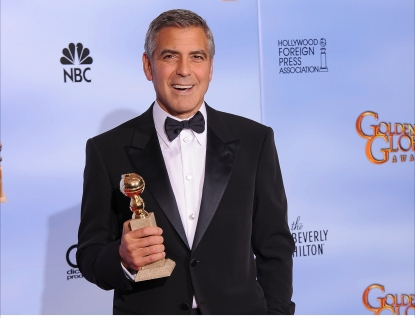 George Clooney poses with the trophy for Best Actor in a Motion Picture, Drama at the 69th annual Golden Globe Awards at the Beverly Hilton Hotel in Beverly Hills