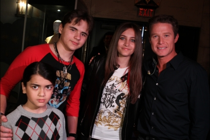 Blanket, Prince and Paris Jackson pose with Access' Billy Bush at the Michael Jackson hand and footprint ceremony in Hollywood on January 26, 2012