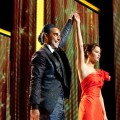 Caesar Flickerman (Stanley Tucci) and Katniss Everdeen (Jennifer Lawrence) in 'The Hunger Games'