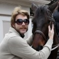 Animal enthusiast/'The Crazy Nastyass Honey Badger' creator Randall poses with a horse
