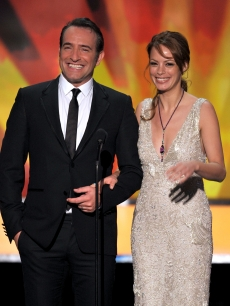 'The Artist' stars Jean Dujardin and Berenice Bejo speak onstage during the 18th Annual Screen Actors Guild Awards at The Shrine Auditorium in Los Angeles on January 29, 2012