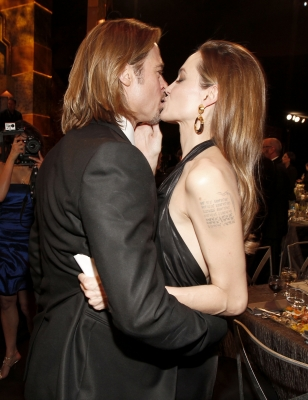 Brad Pitt and Angelina Jolie share a kiss during The 18th Annual Screen Actors Guild Awards at The Shrine Auditorium in Los Angeles on January 29, 2012