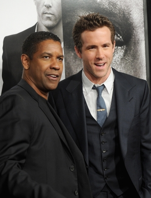 Denzel Washington and Ryan Reynolds are seen at the &#8216;Safe House&#8217; premiere in New York City on February 7, 2012