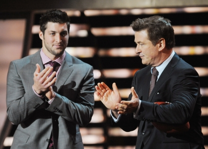 Tim Tebow and Alec Baldwin speak onstage at the 2012 NFL Honors at the Murat Theatre in Indianapolis, Ind., on February 4, 2012