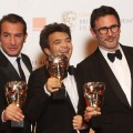 Jean Dujardin, Thomas Langmann and Michel Hazanavicius from the film 'The Artist' pose with their awards in the press room with the Best Actor award during the Orange British Academy Film Awards 2012 at the Royal Opera House on February 12, 2012 in London