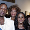Bobby Brown, Whitney Houston and daughter Bobbi Kristina watch the premiere of &#8216;Being Bobby Brown,&#8217; Atlanta, on June 27, 2005