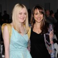 Dakota Fanning and Natalie Portman smile at the Rodarte Fall 2012 fashion show during Mercedes-Benz Fashion Week at the Metropolitan Pavilion in New York City on February 14, 2012