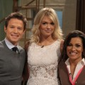 Kate Upton poses with Billy Bush and Kit Hoover on the set of Access Hollywood Live on February 21, 2012