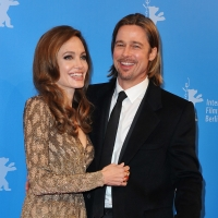 Angelina Jolie and Brad Pitt smile at the &#8216;In The Land Of Blood And Honey&#8217; Premiere at the Haus der Berliner Festspiele in Berlin, Germany, on February 11, 2012 