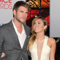 Liam Hemsworth and Miley Cyrus arrive at the People's Choice Awards 2012 at Nokia Theatre LA Live in Los Angeles on January 11, 2012