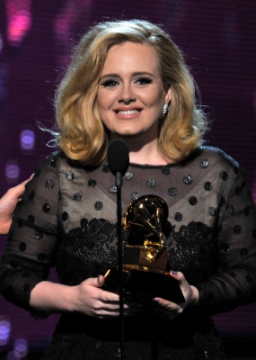 Adele accepts the award for Song of the Year onstage at the 54th Annual Grammy Awards held at Staples Center in Los Angeles on February 12, 2012