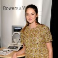 Shailene Woodley checks out a pair of Bowers & Wilkins headphones at the Official Presenter Gift Lounge at the 2012 Film Independent Spirit Awards at Santa Monica Pier in Santa Monica, Calif. on February 25, 2012