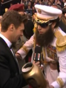 Ryan Seacrest gets ashes dumped on him by Sacha Baron Cohen as &#8216;The Dictator&#8217; on E! Live at the Academy Awards, Hollywood, February 26, 2012