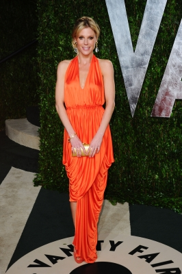 Julie Bowen glows in a bright orange dress at the 2012 Vanity Fair Oscar Pary in West Hollywood, Calif., on February 26, 2012