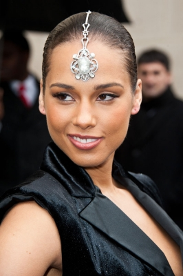 Alicia Keys rocks a head piece at the Chanel Ready-To-Wear Fall/Winter 2012 show as part of Paris Fashion Week at Grand Palais in Paris on March 6, 2012