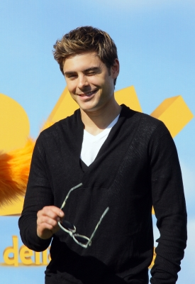 Zac Efron throws a wink at photographers at the 'Dr. Seuss' The Lorax' photocall in Rome on March 9, 2012