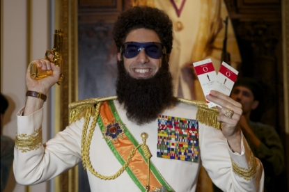 Sacha Baron Cohen (as 'The Dictator' Admiral General Aladeen) shows off a golden gun and Oscar tickets on February 24, 2012