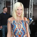Tori Spelling sports a print dress at John Varvatos 9th Annual Stuart House Benefit held at John Varvatos Los Angeles in West Hollywood, Calif. on March 11, 2012