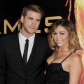 Liam Hemsworth and Miley Cyrus arrive at the premiere of Lionsgate's 'The Hunger Games' at Nokia Theatre L.A. Live in Los Angeles on March 12, 2012