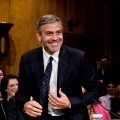 George Clooney smiles as he testifies at the Senate Foreign Relations Sudan and South Sudan: Independence and Insecurity hearing at the Dirksen Senate Office Building in Washington, D.C. on March 14, 2012