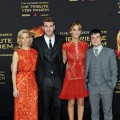 Elizabeth Banks, Liam Hemsworth, Jennifer Lawrence and Josh Hutcherson attend the premiere of 'The Hunger Games' at Cinestar in Berlin, Germany, on March 16, 2012