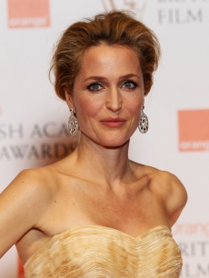 Gillian Anderson poses in the press room at The Orange British Academy Film Awards 2012 at The Royal Opera House on February 12, 2012