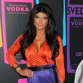 'Real Housewives' star Teresa Giudice sports a bold colors and a deep tan at SVEDKA Vodka's 2nd annual 'Night of a Billion Reality Stars' Bash in Los Angeles on March 29, 2012