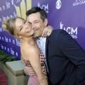 LeAnn Rimes and Eddie Cibrian get extra close on the red carpet of the 47th Annual Academy of Country Music Awards held at the MGM Grand Garden Arena in Las Vegas, Nevada on April 1, 2012