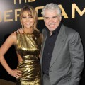 Jennifer Lawrence and director Gary Ross arrive at the premiere 'The Hunger Games' in Los Angeles on March 12, 2012