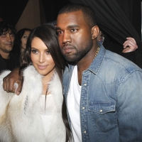 Kim Kardashian and Kanye West attend the Kanye West Ready-To-Wear Fall/Winter 2012 show as part of Paris Fashion Week at Halle Freyssinet in Paris on March 6, 2012