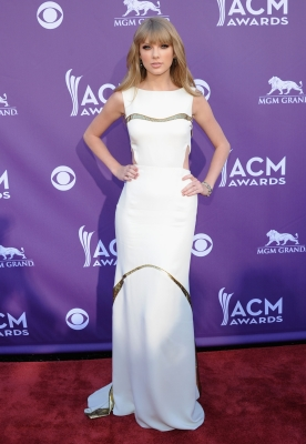 Taylor Swift impresses in a floor-length gown on the red carpet of the 47th Annual Academy of Country Music Awards held at the MGM Grand Garden Arena in Las Vegas, Nevada on April 1, 2012