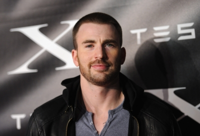 Chris Evans arrives at Tesla Worldwide Debut of Model X in Los Angeles on February 9, 2012