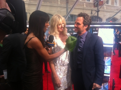 Shaun Robinson shows her superhero strength to Mark Ruffalo at the premiere of 'The Avengers' in Hollywood on April 11, 2012
