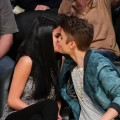 Pucker up! Selena Gomez and Justin Bieber kiss at a basketball game between the San Antonio Spurs and the Los Angeles Lakers at Staples Center in Los Angeles on April 17, 2012 