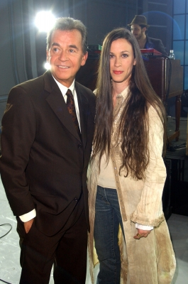 Dick Clark and Alanis Morissette during a taping for &#8216;American Bandstand&#8217;s 50th&#8230;A Celebration!&#8217;, at the Pasadena Civic Auditorium on April 21, 2002