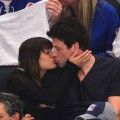 Lea Michele and Cory Monteith share a kiss at the New York Rangers vs New Jersey Devils playoff game at Madison Square Garden in New York City on May 16, 2012