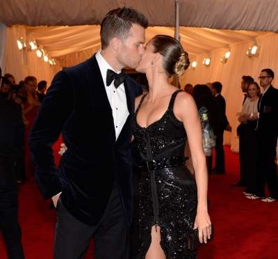 Tom Brady and Gisele Bundchen kiss at the 'Schiaparelli And Prada: Impossible Conversations' Costume Institute Gala at the Metropolitan Museum of Art in New York City on May 7, 2012
