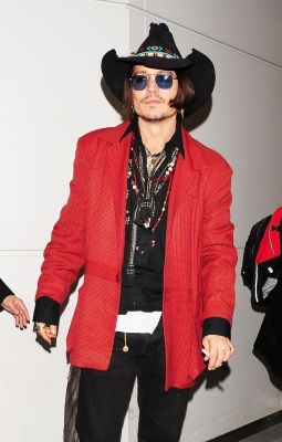 Johnny Depp rocks a western look while arriving at Narita International Airport Narita, Japan, on May 12, 2012