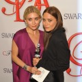 Ashley Olsen and Mary Kate Olsen pose with thier award at the 2012 CFDA Fashion Awards at Alice Tully Hall in New York City on June 4, 2012