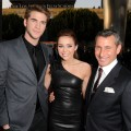 Liam Hemsworth, Miley Cyrus and producer Adam Shankman arrive at the premiere of Touchstone Picture's 'The Last Song' held at ArcLight Hollywood on March 25, 2010