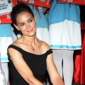 Katie Holmes is all smiles at the 'Artistry on Ice' press conference at Sheraton Hotel in Beijing, China on June 11, 2012