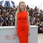 Nicole Kidman glows in an orange dress during the photocall of 'The Paperboy' presented in competition at the 65th Cannes film festival in Cannes on May 24, 2012