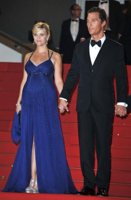 Reese Witherspoon and Matthew McConaughey stroll hand-in-hand at the &#8216;Mud&#8217; premiere during the 65th Annual Cannes Film Festival in Cannes, France on May 26, 2012