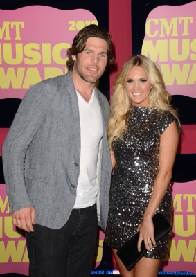 Mike Fisher and wife Carrie Underwood arrive at the 2012 CMT Music awards at the Bridgestone Arena in Nashville on June 6, 2012