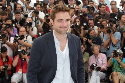 Robert Pattinson is all smiles during the photocall of 'Cosmopolis' presented in competition at the 65th Cannes film festival in Cannes on May 25, 2012