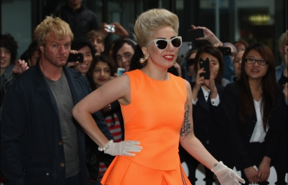 Lady Gaga greets fans as she arrives at the Stamford Plaza in Auckland, New Zealand on June 5, 2012 